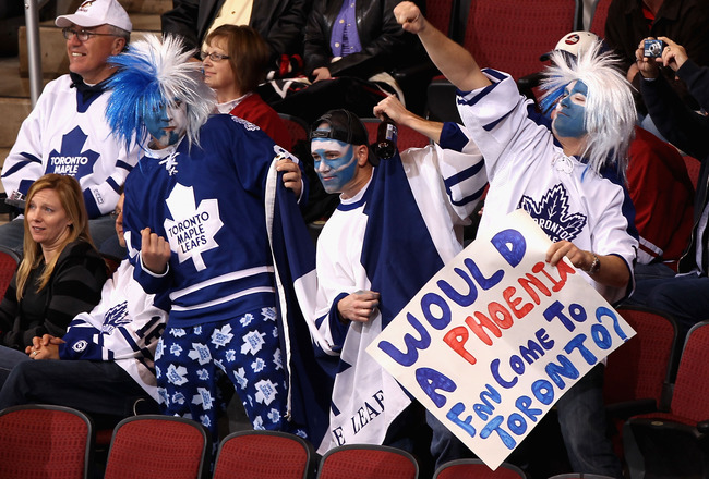 GLENDALE, AZ - JANUARY 13:  Fans of the Toronto Maple Leafs cheer during the NHL game against the Phoenix Coyotes at Jobing.com Arena on January 13, 2011 in Glendale, Arizona.  (Photo by Christian Petersen/Getty Images)
