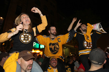 BOSTON, MA - JUNE 15:  Fans of the Boston Bruins celebrate outside of TD Banknorth Garden after the Boston Bruins defeated the Vancouver Canucks to win Game Seven of the 2011 Stanley Cup Final on June 15, 2011 in Boston, Massachusetts. (Photo by Jim Rogas