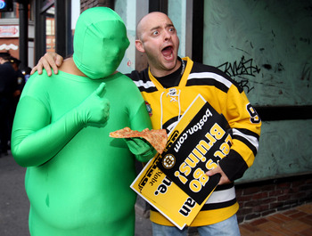 BOSTON, MA - JUNE 08:  A fan of the Boston Bruins poses for a photo with a man in a green suit prior to Game Four of the 2011 NHL Stanley Cup Final between the Vancouver Canucks and the Boston Bruins at TD Garden on June 8, 2011 in Boston, Massachusetts.