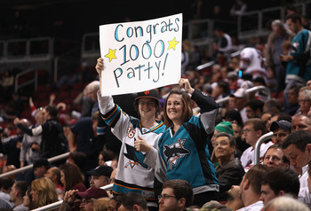 GLENDALE, AZ - JANUARY 17:  Fans of the San Jose Sharks hold up a sign in honor of Patrick Marleau (not pictured) playing in his 1,000th career game during the NHL game against the Phoenix Coyotes at Jobing.com Arena on January 17, 2011 in Glendale, Arizo