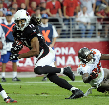 GLENDALE, AZ - OCTOBER 31:  Larry Fitzgerald #11 of the Arizona Cardinals gets past Aqib Talib #25 of the Tampa Bay Buccaneers to score a touchdwon for a 35-31 lead during the fourth quarter at University of Phoenix Stadium on October 31, 2010 in Glendale