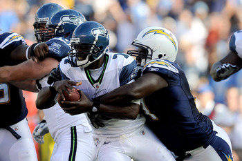 SAN DIEGO, CA - AUGUST 11:  Quarterback Tarvaris Jackson #7 of the Seattle Seahawks is sacked by Ogemdi Nwagbuo #91 of the San Diego Chargers in the second quarter during the NFL preseason game at Qualcomm Stadium on August 11, 2011 in San Diego, Californ