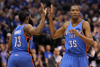 DALLAS, TX - MAY 19:  (R) Kevin Durant #35 of the Oklahoma City Thunder gives a five to teammate James Harden #13 in the second half while taking on the Dallas Mavericks in Game Two of the Western Conference Finals during the 2011 NBA Playoffs at American