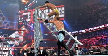 Christian knocks Alberto Del Rio off a ladder at Extreme Rules 2011 before climbing it himself to win the World Heavyweight Championship (Photo by WWE.com)