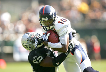 OAKLAND, CA - SEPTEMBER 27:  Brandon Marshall #15 of the Denver Broncos is tackled by Kirk Morrison #52 of the Oakland Raiders at the Oakland-Alameda County Coliseum on September 27, 2009 in Oakland, California.  (Photo by Ezra Shaw/Getty Images)