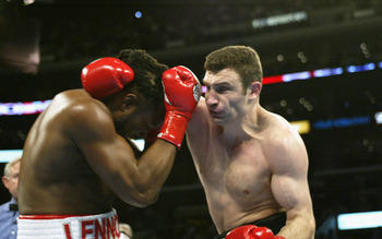 Vitali impressed against Lennox Lewis, but was forced to retire after sustaining a deep cut just beneath his left eye