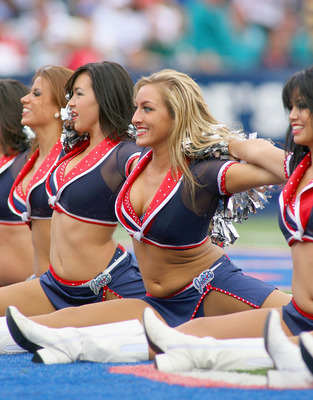 ORCHARD PARK, NY - SEPTEMBER 12: Members of  the Buffalo Jills cheerleading squad fininish a routine during the NFL season opener against the Miami Dolphins  at Ralph Wilson Stadium on September 12, 2010 in Orchard Park, New York.  (Photo by Rick Stewart/