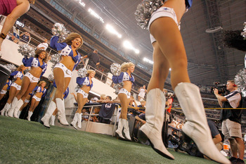 ARLINGTON, TX - AUGUST 12:  The Dallas Cowboys Cheerleaders take to the field during the preason game between the Dallas Cowboys and Oakland Raiders at Dallas Cowboys Stadium on August 12, 2010 in Arlington, Texas.  (Photo by Tom Pennington/Getty Images)