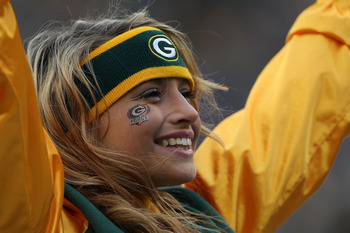 GREEN BAY, WI - DECEMBER 05: A cheerleader for the Green Bay Packers performs during a game against the San Francisco 49ers at Lambeau Field on December 5, 2010 in Green Bay, Wisconsin. The Packers defeated the 49ers 34-16. (Photo by Jonathan Daniel/Getty