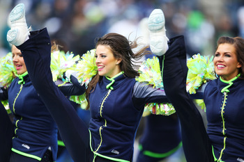 SEATTLE, WA - JANUARY 08:  Seattle Seahawks cheerleaders perform during their game against the New Orleans Saints during the 2011 NFC wild-card playoff game at Qwest Field on January 8, 2011 in Seattle, Washington.  (Photo by Otto Greule Jr/Getty Images)
