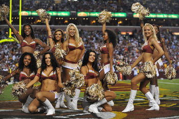 LANDOVER - SEPTEMBER 12:  Cheerleaders for the Washington Redskins pose after a routine during the NFL season opener against the Dallas Cowboys at FedExField on September 12, 2010 in Landover, Maryland. The Redskins defeated the Cowboys 13-7. (Photo by La