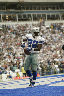 IRVING, TX - OCTOBER 27:   Running Back Emmitt Smith #22 of the Dallas Cowboys celebrates beating the NFL rushing record during the NFL game against the Seattle Seahawks at Texas Stadium on October 27, 2002 in Irving, Texas. The Seahawks defeated the Cowb