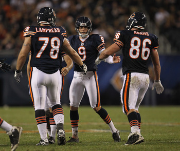 CHICAGO, IL - AUGUST 13: Robbie Gould #9 of the Chicago Bears is congratulaed by Mike Lamphear #78 and Kyle Adams #86 after kicking a field goal against the Buffalo Bills during a preseason game at Soldier Field on August 13, 2011 in Chicago, Illinois. Th