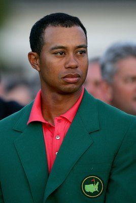 AUGUSTA, GA - APRIL 09:  Tiger Woods sits at the green jacket presentation before presenting Mickelson with the green jacket for winning The Masters at the Augusta National Golf Club after the final round on April 9, 2006 in Augusta, Georgia.  Mickelson w