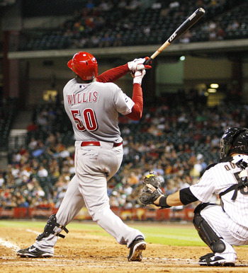 HOUSTON - AUGUST 03:  Pitcher Dontrelle Willis #50 of the Cincinnati Reds hits a home run to right field in the seventh inning against the Houston Astros at Minute Maid Park on August 3, 2011 in Houston, Texas.  (Photo by Bob Levey/Getty Images)