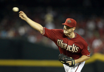 PHOENIX, AZ - AUGUST 14:  Starting pitcher Jason Marquis #21 of the Arizona Diamondbacks pitches against the New York Mets during the Major League Baseball game at Chase Field on August 14, 2011 in Phoenix, Arizona.  (Photo by Christian Petersen/Getty Ima