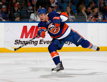 UNIONDALE, NY - MARCH 24:  PA Parenteau #15 of the New York Islanders shoots during warmups before an NHL hockey game against the Atlanta Thrashers at the Nassau Coliseum on March 24, 2011 in Uniondale, New York.  (Photo by Paul Bereswill/Getty Images)