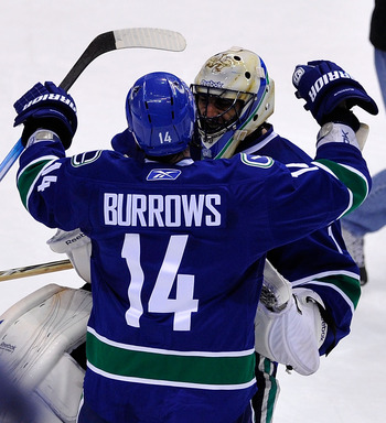 VANCOUVER, BC - JUNE 10:  Alex Burrows #14 and Roberto Luongo #1 of the Vancouver Canucks celebrate after defeating the Boston Bruins by a score of 1-0 in Game Five of the 2011 NHL Stanley Cup Final at Rogers Arena on June 10, 2011 in Vancouver, British C