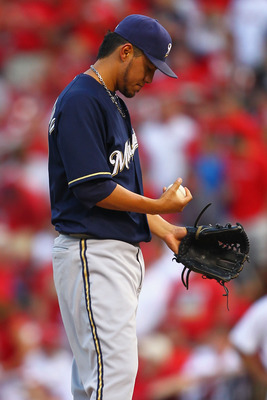 ST. LOUIS, MO - AUGUST 11: Starter Yovani Gallardo #49 of the Milwaukee Brewers reacts to giving up a solo home run against the St. Louis Cardinals at Busch Stadium on August 11, 2011 in St. Louis, Missouri.  (Photo by Dilip Vishwanat/Getty Images)