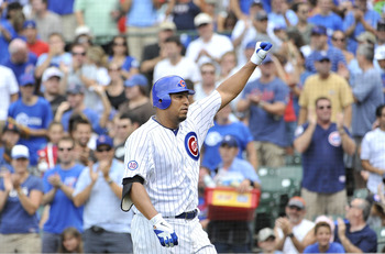 CHICAGO, IL - AUGUST 06:  Carlos Zambrano #38 of the Chicago Cubs raises his fist after hitting a solo home run during the third inning against the Cincinnati Reds at Wrigley Field on August 6, 2011 in Chicago, Illinois.  (Photo by Brian Kersey/Getty Imag