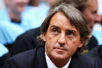 LONDON, ENGLAND - AUGUST 07:  Manchester City manager Roberto Mancini looks on ahead of the FA Community Shield match sponsored by McDonald's between Manchester City and Manchester United at Wembley Stadium on August 7, 2011 in London, England.  (Photo by
