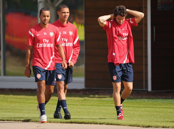 ST ALBANS, ENGLAND - AUGUST 09:  Cesc Fabregas of Arsenal is seen with team mates Kieran Gibbs and Theo Walcott during the England training session at London Colney on August 9, 2011 in St Albans, England.  (Photo by Michael Regan/Getty Images)