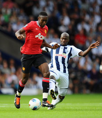 WEST BROMWICH, ENGLAND - AUGUST 14: Danny Welbeck of Manchester United is challenged by Youssouf Mulumbu of West Bromwich Albion during the Barclays Premier League match between West Bromwich Albion and Manchester United at The Hawthorns on August 14, 201