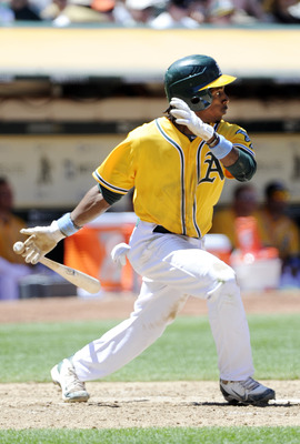 OAKLAND, CA -  JUNE 19: Jemile Weeks #19 of the Oakland Athletics swings and watches the flight of his ball as he doubles to left-center against the San Francisco Giants in the bottom of the sixth inning during a MLB baseball game June 19, 2011 at the Oak
