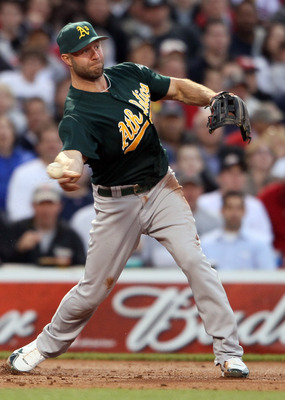 BOSTON, MA - JUNE 03:  Kevin Kouzmanoff #5 of the Oakland Athletics sends a hit by Dustin Pedroia of the Boston Red Sox to second for the out in the second inning on June 3, 2011 at Fenway Park in Boston, Massachusetts.  (Photo by Elsa/Getty Images)