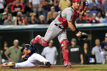 CLEVELAND, OH - JULY 26: Orlando Cabrera #20 of the Cleveland Indians is out at home as catcher Jeff Mathis #5 of the Los Angeles Angels throws to first for a double play during the ninth inning at Progressive Field on July 26, 2011 in Cleveland, Ohio. Th