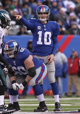 EAST RUTHERFORD, NJ - DECEMBER 19:  Eli Manning #10 of the New York Giants against the Philadelphia Eagles at New Meadowlands Stadium on December 19, 2010 in East Rutherford, New Jersey.  (Photo by Nick Laham/Getty Images)
