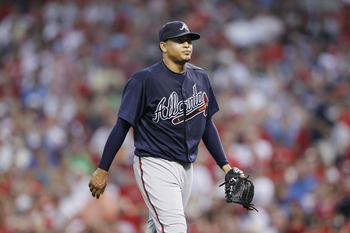 CINCINNATI, OH - JULY 22: Jair Jurrjens #49 of the Atlanta Braves walks to the dugout after giving up two home runs in the sixth inning against the Cincinnati Reds at Great American Ball Park on July 22, 2011 in Cincinnati, Ohio. (Photo by Joe Robbins/Get