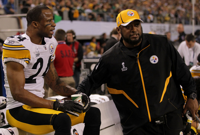 ARLINGTON, TX - FEBRUARY 06:  Ike Taylor #24 of the Pittsburgh Steelers talks with head coach Mike Tomlin of the Pittsburgh Steelers during Super Bowl XLV against the Green Bay Packers at Cowboys Stadium on February 6, 2011 in Arlington, Texas.  (Photo by