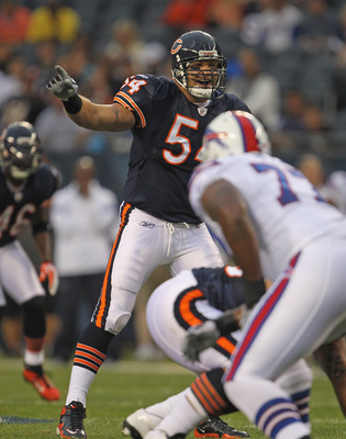 CHICAGO, IL - AUGUST 13: Brian Urlacher #54 of the Chicago Bears calls defensive signals against the Buffalo Bills during a preseason game at Soldier Field on August 13, 2011 in Chicago, Illinois. The Bears defeated the Bills 10-3. (Photo by Jonathan Dani
