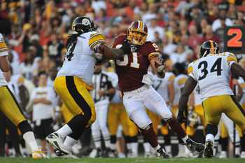 LANDOVER, MD - AUGUST 12:  Ryan Kerrigan #91 of the Washington Redskins defends against the Pittsburgh Steelers  at FedExField on August 12, 2011 in Landover, Maryland. The Redskins defeated the Steelers 16-7. (Photo by Larry French/Getty Images)