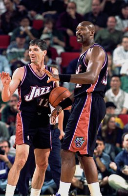 3 May 2000:   John Stockton #12 and Karl Malone #32 of the Utah Jazz make a hand gesture to some teamates during the NBA Western Conference Playoffs Round One Game against the Seattle SuperSonics at Key Arena in Seattle, Washington. The SuperSonics defeat