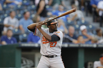 KANSAS CITY, MO - AUGUST 04: Vladimir Guerrero #27 of the Baltimore Orioles bats during a game against the Kansas City Royals at Kauffman Stadium on August 4, 2011 in Kansas City, Missouri. The Kansas City Royals won 9-4. (Photo by Ed Zurga/Getty Images)
