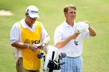 JOHNS CREEK, GA - AUGUST 13:  David Toms waits in the 18th fairway with his caddie Scott Gneiser during the third round of the 93rd PGA Championship at the Atlanta Athletic Club on August 13, 2011 in Johns Creek, Georgia.  (Photo by Andrew Redington/Getty