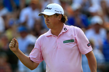 JOHNS CREEK, GA - AUGUST 14:  Jason Dufner  celebrates a birdie putt on the 13th green during the final round of the 93rd PGA Championship at the Atlanta Athletic Club on August 14, 2011 in Johns Creek, Georgia.  (Photo by Sam Greenwood/Getty Images)