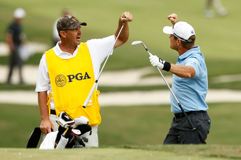 JOHNS CREEK, GA - AUGUST 14:  Scott Verplank celebrates with his caddie Scott Tway on the 16th hole during the final round of the 93rd PGA Championship at the Atlanta Athletic Club on August 14, 2011 in Johns Creek, Georgia.  (Photo by Mike Ehrmann/Getty