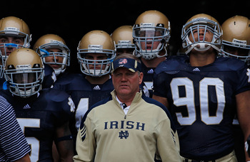 SOUTH BEND, IN - SEPTEMBER 11: Head coach Brian Kelly of the Notre Dame Fighting Irish waits to enter the field with his team including Armando Allen, Jr. #5, Carlo Calabrese #44 and Ethan Johnson #90 before a game against the Michigan Wolverines at Notre