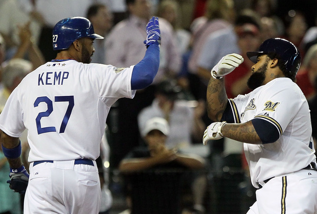 PHOENIX, AZ - JULY 12:  (R) National League All-Star Prince Fielder #28 of the Milwaukee Brewers hits a three-run home run in the fourth inning and celebrates with teammate Matt Kemp #27 of the Los Angeles Dodgers of the 82nd MLB All-Star Game at Chase Fi