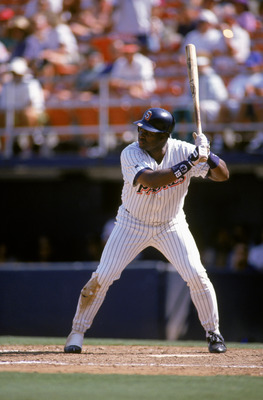 SAN DIEGO - AUGUST 31:  Tony Gwynn #19 of the San Diego Padres waits for the pitch during a game against the Montreal Expos at Jack Murphy Stadium on August 31, 1995 in San Diego, California. The Expos defeated the Padres 5-4. (Photo by Stephen Dunn/Getty