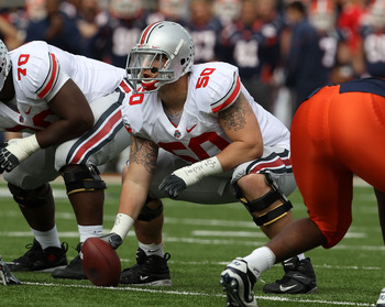 CHAMPAIGN, IL - OCTOBER 02: Mike Brewster #50 of the Ohio State Buckeyes waits to snap the ball against the Illinois Fighting Illini at Memorial Stadium on October 2, 2010 in Champaign, Illinois. Ohio State defeated Illinois 24-13.  (Photo by Jonathan Dan