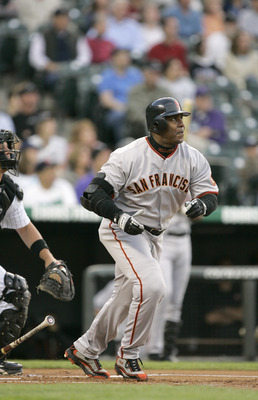 DENVER - APRIL 21: Barry Bonds #25 of the San Francisco Giants makes a hit during the game against the Colorado Rockies on April 21, 2005 at Coors Field in Denver, Colorado.  The Rockies won 9-8.  (Photo by Brian Bahr/Getty Images)
