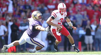SEATTLE - SEPTEMBER 18: Quarterback Taylor Martinez #3 of the Nebraska Cornhuskers rushes against Sione Potoa'e #55 of the Washington Huskies on September 18, 2010 at Husky Stadium in Seattle, Washington. (Photo by Otto Greule Jr/Getty Images)