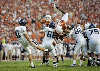 AUSTIN, TX - SEPTEMBER 20: Malcolm Williams #9 of the Texas Longhorns tries to block a punt by Kyle Martens #41 of the Rice Owls in the second quarter on September 20, 2008 at Darrell K Royal-Texas Memorial Stadium in Austin, Texas.  (Photo by Brian Bahr/