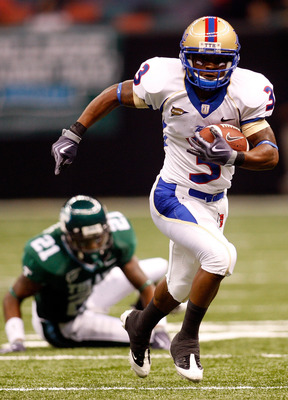 NEW ORLEANS - SEPTEMBER 04:  Damaris Johnson #3 of the Tulsa Golden Hurricanes runs past Charles Harris #21 of the Tulane Green Wave at the Louisiana Superdome on September 4, 2009 in New Orleans, Louisiana.  (Photo by Chris Graythen/Getty Images)