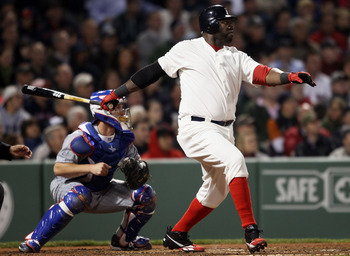 BOSTON, MA - MAY 21:  David Ortiz #34 of the Boston Red Sox hits a two run homer in the fourth inning as Koyie Hill #55 of the Chicago Cubs catches on May 21, 2011 at Fenway Park in Boston, Massachusetts. Tonight the Chicago Cubs and the Boston Red Sox ar