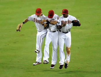PHOENIX, AZ - AUGUST 12:  Gerardo Parra #8 of the Arizona Diamondbacks and teammates Justin Upton #10 and Chris Young #24 celebrate a win against the New York Mets at Chase Field on August 12, 2011 in Phoenix, Arizona.  Arizona won 4-3.(Photo by Norm Hall